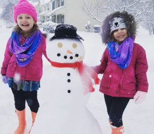 kids with snowman, girls with snowman