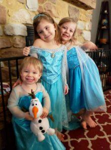 three girls dressed like princess