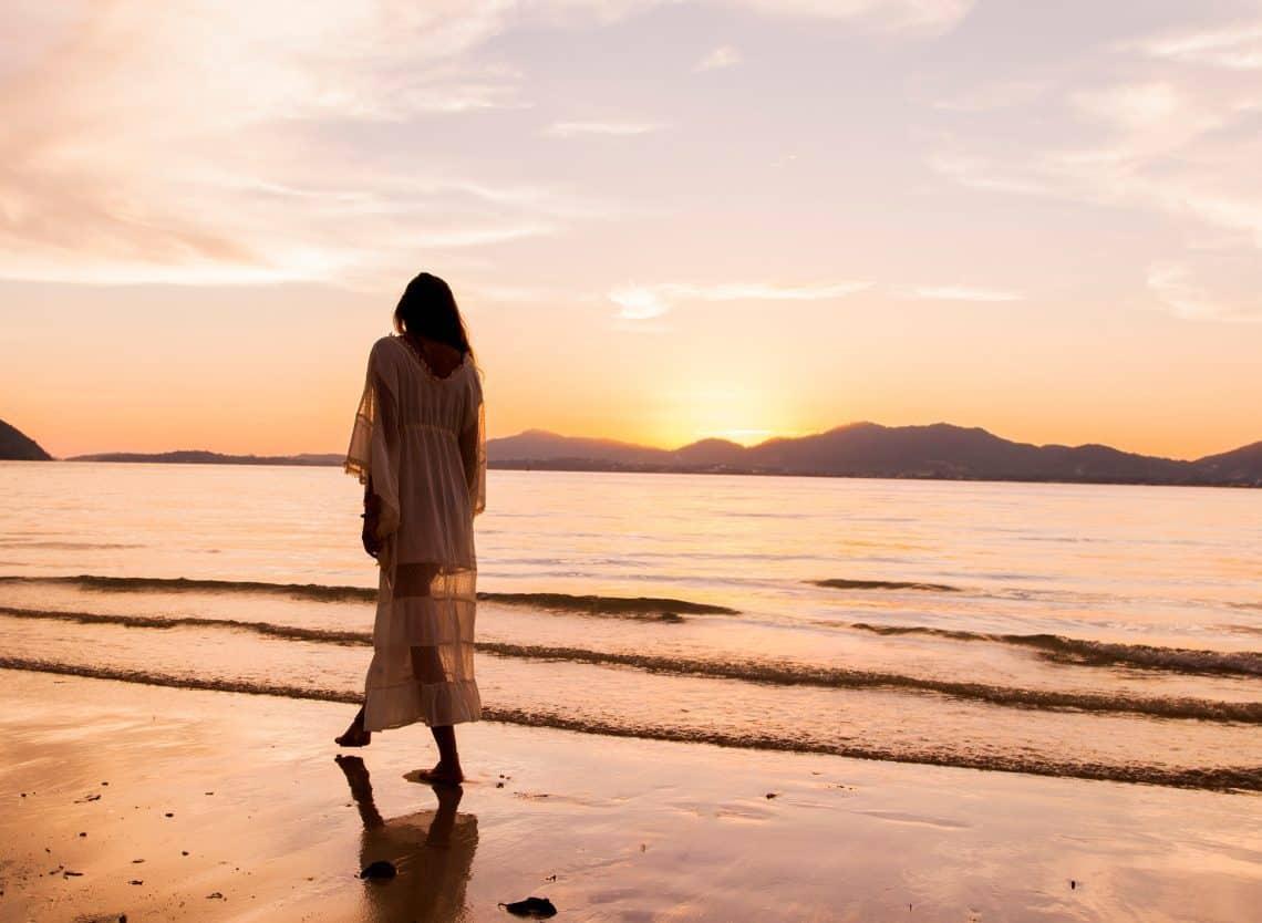 Canva - Woman iIn White Dress Walking On Beach